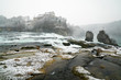 Rhine Falls in Switzerland on a winter day with snow falling