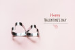 Valentine's card. Creative couple heart cookie cutters on pink. Negative space for text.