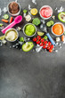 Trendy vegan food, summer healthy dessert concept, colorful diet vegetable ice cream with avocado, cucumber, tomato, beet, carrot, broccoli, cauliflower. Frozen veggie smoothie, black background