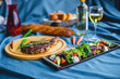 beef steak with salad, bread and wine on the table - 242624789