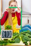 Woman having green diet vegetables, detox sign - 242625331