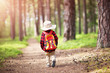 Leinwanddruck Bild - boy going camping with backpack in nature