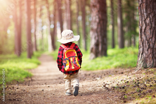 Leinwanddruck Bild boy going camping with backpack in nature