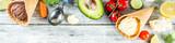 Trendy vegan food, summer healthy dessert concept, colorful diet vegetable ice cream with avocado, cucumber, tomato, beet, carrot, broccoli, cauliflower. Frozen veggie smoothie, wooden background