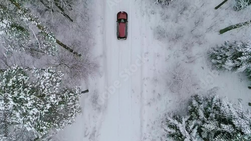 Aerial view of car on road in beautiful winter scenery