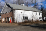 Old rustic weathered wooden barn abandoned in New England Village - 242639996
