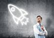 Leinwanddruck Bild - Elegant banker wearing red tie and rocket sign as technology con