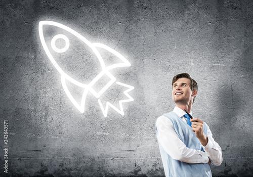 Leinwanddruck Bild Elegant banker wearing red tie and rocket sign as technology con