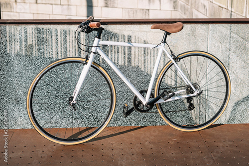 City bicycle fixed gear on broken glass wall