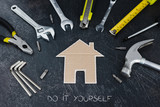 home renovation set of DIY tools and little cardboard house - 242647745