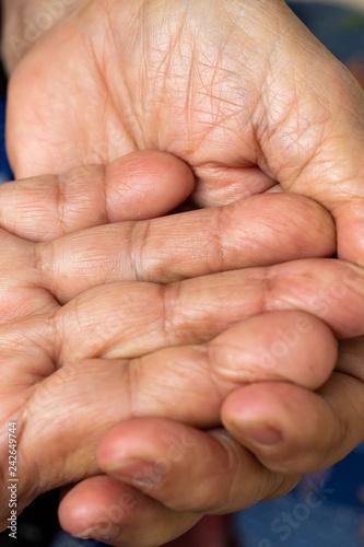 Leinwanddruck Bild Senior woman's wrinkled palm and fingerprint of hand, Close up & Macro shot, Selective focus, Asian body skin part, Healthcare concept