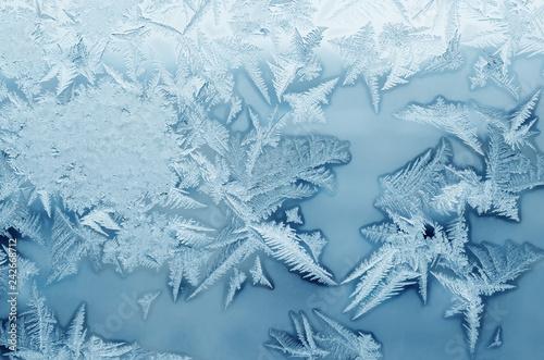 Leinwanddruck Bild Abstract frosty pattern on glass, background texture