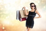 Young woman with shopping bags on   background - 242669371