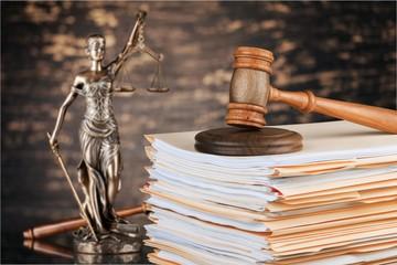 Judge hammer and documents on  background © BillionPhotos.com