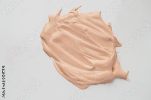 Concealer, light beige makeup, smear cream base, Foundation on white background.