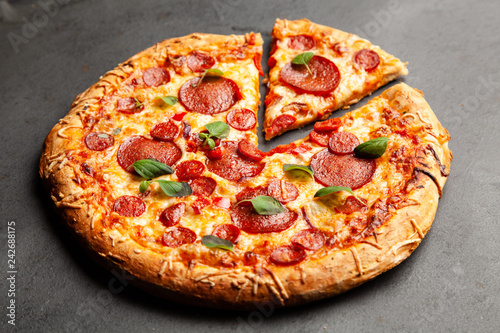 Pizza with salami and chorizo - 242688175