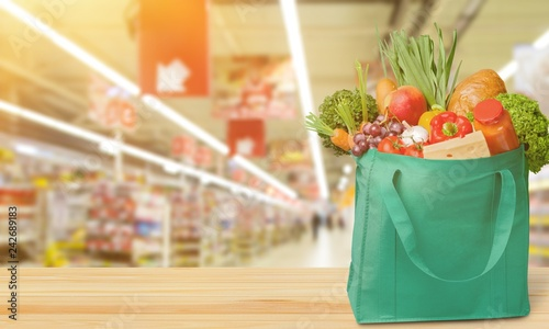 Leinwanddruck Bild Full shopping  bag, isolated over  background