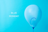blue balloon with a sad face and text blue monday