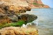 Quadro beautiful sea landscape, closeup of stone on the beach, sea coast with high hills, wild nature