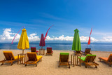 Tropical Beach and Empty Deck Chairs