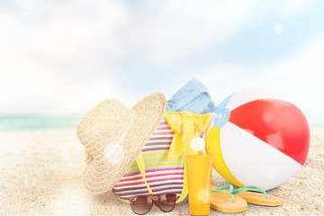 , bag, sunglasses on a tropical beach