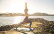 Beautiful girl doing yoga next to the sea