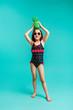 Quadro Stylish girl in swimwear with a green coloured pineapple