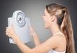 Leinwanddruck Bild - Beautiful young s woman holding scales