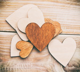 Lots of wooden hearts on the wooden table - 242721324