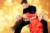 Man and a woman dancing Salsa on background - 242744597