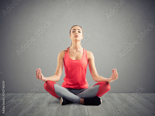 Wall mural Young girl relaxing in yoga position