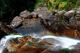 Water fall inside a ravine in the Huancayo mountain range, a place full of nature and tranquility - 242747191
