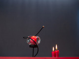 Concept of love Red candles lit with a gray background - 242748526