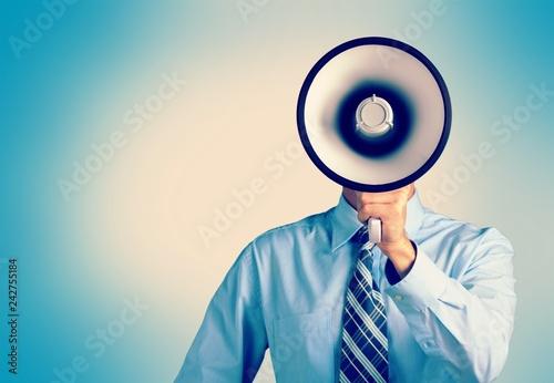 Leinwanddruck Bild Man hand holding megaphone