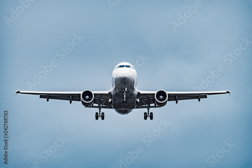 Landing of the passenger plane under the rain.