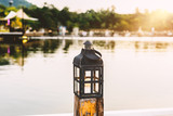 vintage lamps on wooden pole in evening day - 242771518