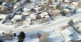 Aerial view of a typical residential area in Colorado Front Range in winter scenery with a fresh snow - 242772164