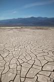 Death Valley Nation Park - Deep Dry Cracks on Desert Ground - 242784149