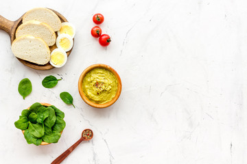 Healthy breakfast. Toasts with vegetables and guacamole on white background top view copy space © 9dreamstudio