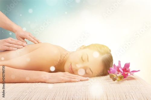 Leinwanddruck Bild Beautiful young woman relaxing with  massage at beauty spa