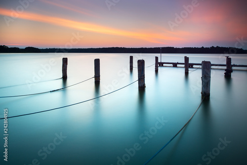 Acrylglas Pier Lake at Sunset, Wooden Posts with Ropes