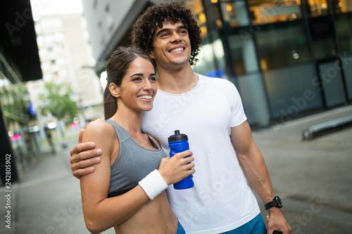 Leinwanddruck Bild Beautiful sporty couple running and jogging outdoor