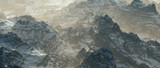 Aerial of rough bare mountains with snow on hazy morning. - 242817515