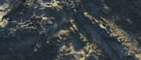 Aerial of rough bare mountains with snow in morning sunlight. - 242817517