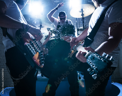 The guitarists and drummer play music - 242818756