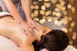 Leinwanddruck Bild - people, beauty, healthy lifestyle and relaxation concept - beautiful young woman lying and having back massage at spa parlor