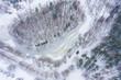 Leinwanddruck Bild - Aerial view of frozen lake.  Winter scenery. Landscape photo captured with drone above winter wonderland. Poland.