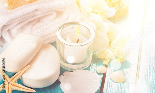 Healthy spa concept with handmade soap bars, oil bottles, towel