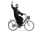 Priest riding a bicycle and waving - 242849917
