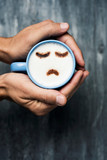 man with a cup of cappuccino with a sad face - 242852786